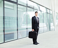 A businessman standing in front of the office