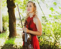 A women in a red dress is holding a violin in her hand