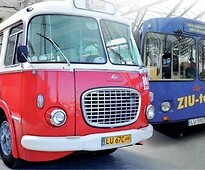 Gutek (the red bus) and Ziutek (the blue bus)