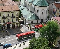 Bus and the trolleybus passing on the Królewska Street in the Lublin City Centre