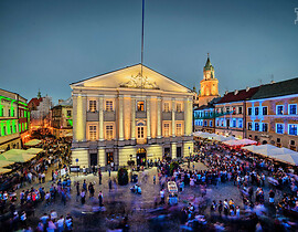 Lublin's Trybunal Koronny lightened on the Rynek Street with crowds of people...